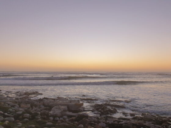 gentle sunset colours as evening falls over the waves