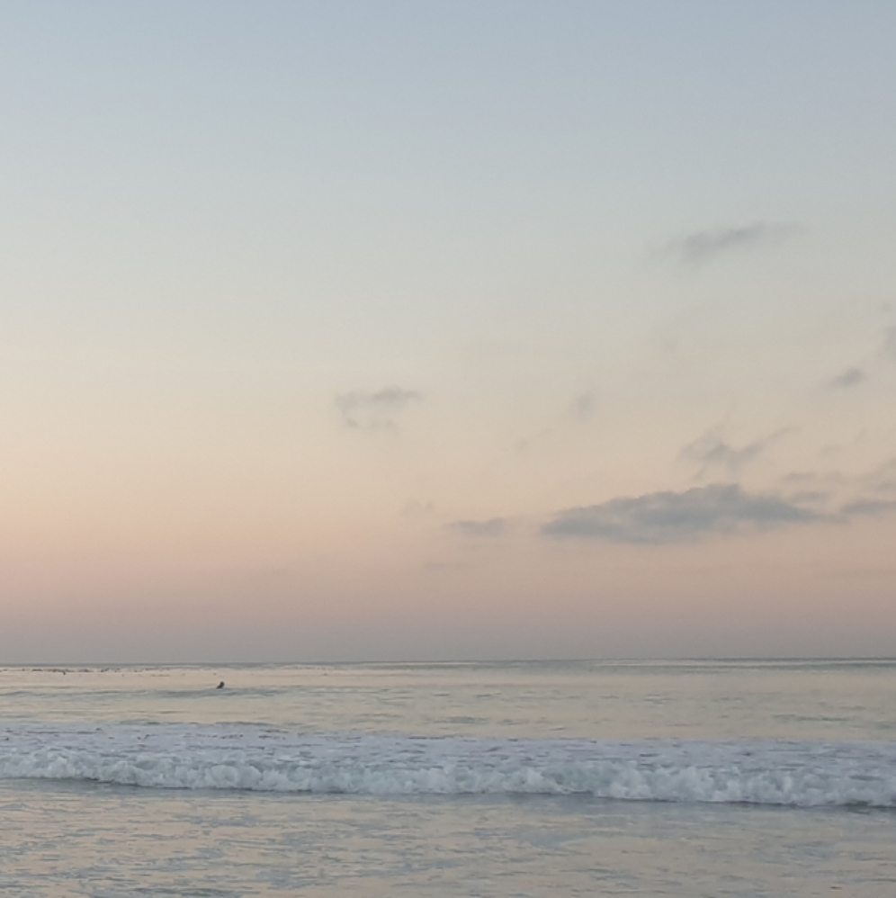gentle dawn sunrise colours in the ocean shallows