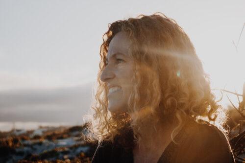 smiling woman in sun rays