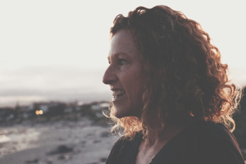 back lit curly hair woman