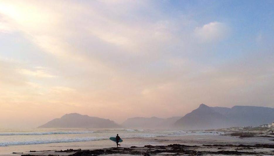 dawn patrol surfer on the beach