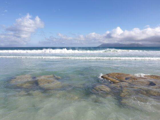 clear sea over rocks