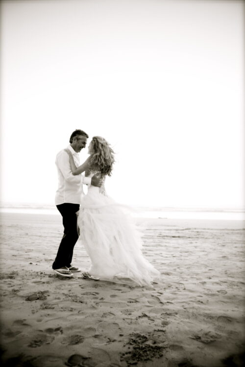 our wedding - bride and groom dancing on the beach