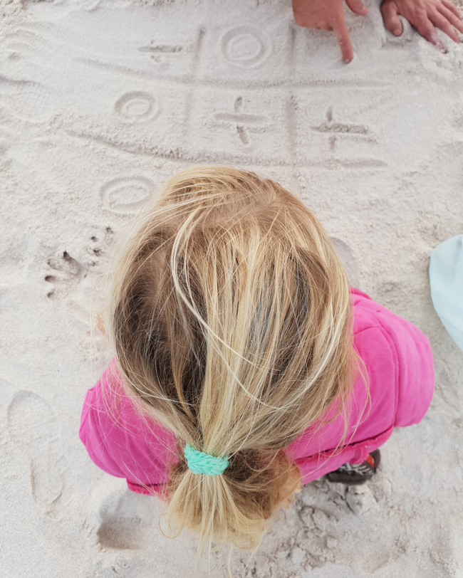 noughts and crosses on the beach sand