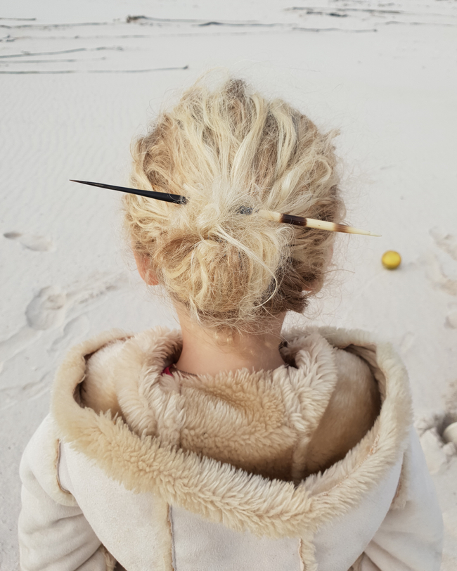 porcupine quill in her hair