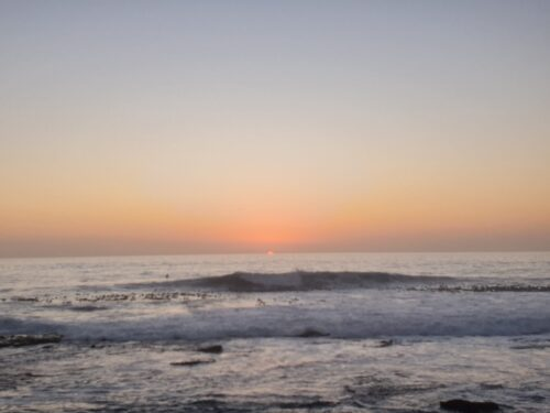 sunset meditations - a wave with pink setting sun