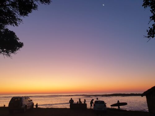 crescent moon and surfer and dusky silhouette sea
