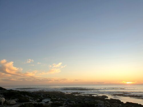 pink peach clouds at sunset above a calm sea